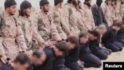 Mayakan ISIL Suna yiwa mutane kisan gilla.