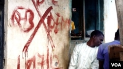 This building, like most in the settlement called Mpape, is marked for demolition with a red 'X,' in Abuja, Nigeria, August 2012. Residents say since the buildings were tagged, crime has gone up and many families already have moved out. (VOA - H. Murdock)