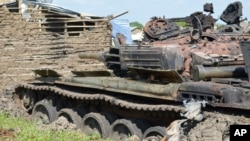 Tanks that have been destroyed during fighting between government and opposition are seen on July 10, 2016, in the Jabel area of Juba, South Sudan, July 16, 2016.