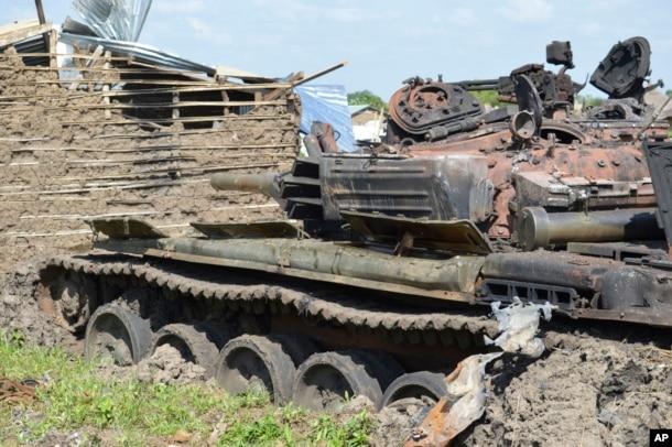 FILE - Tanks destroyed during fighting between forces of Salva Kiir and Riek Machar in Jabel area of Juba, South Sudan, July 16, 2016.