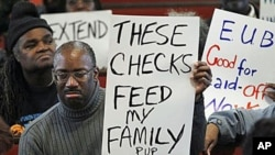 """Frank Wallace who is unemployed displays a sign during a """"Vigil for the Unemployed"""" at the Arch Street Methodist Church in Philadelphia, 22 Nov 2010"""