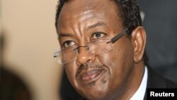 Somalia Prime Minister Abdi Farah Shirdon listens to a question from the media in Mogadishu, Oct. 6, 2012.