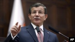 Turkish Prime Minister Ahmet Davutoglu addresses his lawmakers at the parliament in Ankara, Jan. 26, 2016. Davutoglu reiterated Turkey's opposition to including Syrian Kurdish forces at the Geneva talks.
