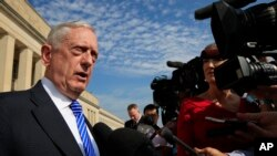 FILE - U.S. Defense Secretary Jim Mattis speaks to reporters at the Pentagon, July 27, 2018.