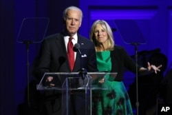 FILE - Vice President Joe Biden, left, and Jill Biden speak in celebration of World AIDS Day at Carnegie Hall in New York, Dec. 1, 2015.