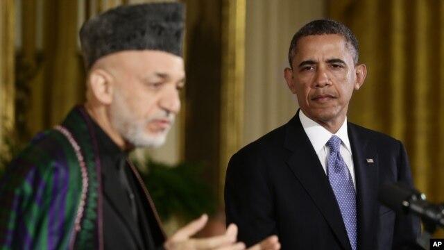 Tổng thống Barack Obama và Tổng thống Afghanistan Hamid Karzai tại cuộc họp báo ở Tòa Bạch Ốc, ngày 11/1/2013. (AP Photo/Charles Dharapak)