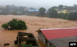 This picture shows flooded streets in Regent near Freetown, Aug. 14, 2017.