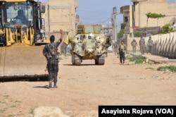 Kurdish forces are seen in Qamishli, April 21, 2016.