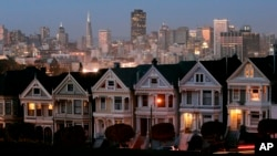 "FILE - In this Monday, May 12, 2008 file photo, the ""Painted Ladies,"" a row of historical Victorian homes, underscore the San Francisco skyline in a view from Alamo Square. San Francisco enjoys the benefits of tech fortunes, but its homes are largely unaffordable for most people. (AP Photo/Marcio Jose Sanchez)"
