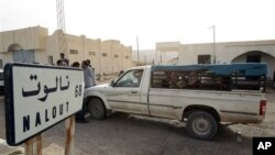 A van crosses the Tunisian-Lybian border of Dhuheiba, Tunisia, Thursday, April 21, 2011.