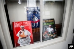 Cookbooks by Chef Paul Prudhomme are displayed in a window at K-Paul's Louisiana Kitchen in the French Quarter of New Orleans, Oct. 8, 2015.