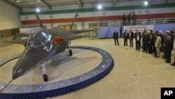 Iran's newest fighter jet, Qaher-313, or Dominant-313, is unveiled by Iranian President Mahmoud Ahmadinejad, accompanied by top officials during a ceremony, in Tehran, Iran, Saturday, Feb. 2, 2013. Ahmadinejad unveiled the country's newest fighter jet, wh