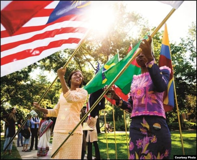 International students wave their national flags at the University of Missouri in Columbia, Missouri.