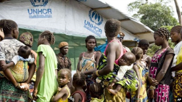 Refugees, who fled the post-election instability in Ivory Coast, wait to be registered at a camp in Liberia