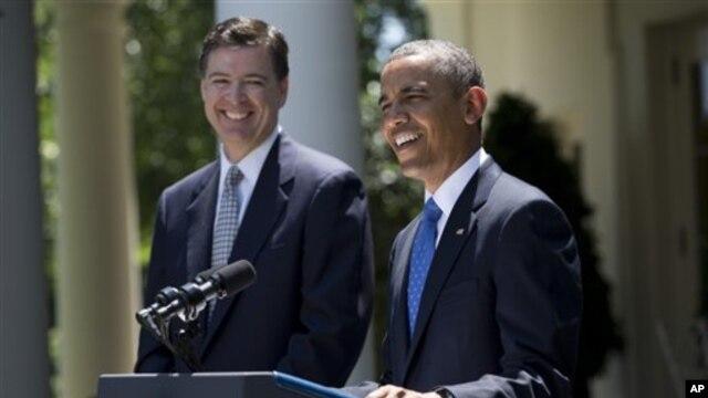 President Barack Obama with James Comey, left, at White House June 21, 2013