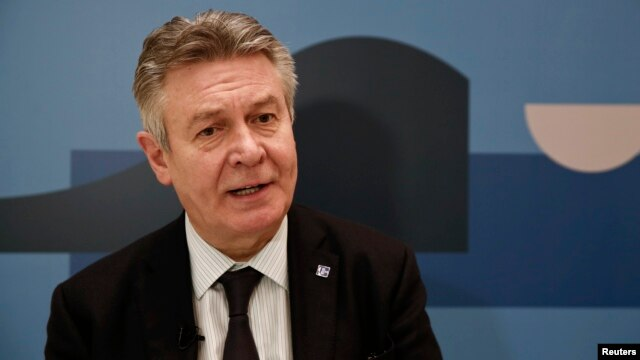 The European Union's trade chief Karel De Gucht answers a question during an interview in Athens, Feb. 28, 2014.