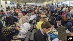People waiting screening at a United States airport.