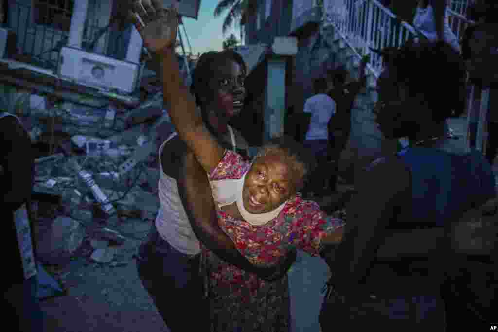 Oxiliene Morency grieves after the body of her 7-year-old-daughter Esther Daniel was recovered from the rubble of their home destroyed by the earthquake in Les Cayes, Haiti, Aug. 14, 2021.