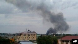 FILE - Black smoke rises above Juba, South Sudan, July 10, 2016. U.S. military has deployed about 40 soldiers to South Sudan's capital following days of clashes that left hundreds dead and raised fears of renewed civil war.