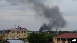 FILE - Black smoke rises above Juba, South Sudan, July 10, 2016. Explosions and heavy weapons gunfire shook the city as government and opposition forces clashed.