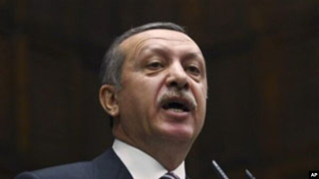 Turkey's Prime Minister Recep Tayyip Erdogan addresses lawmakers in Ankara, Nov. 15, 2011