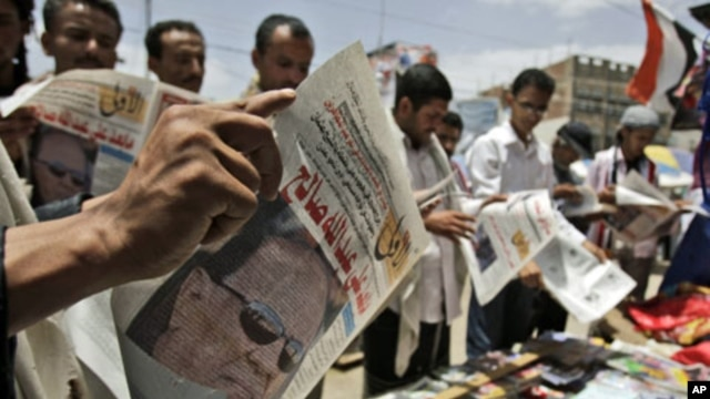 Anti-government protesters read local newspapers featuring a photograph of Vice President Abed Rabbo Mansour Hadi, and a headline that reads in Arabic, 'What's After Ali Abdullah Saleh', in Sana'a, Yemen, June 7, 2011
