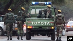 Zimbabwean soldiers who are thought to be escorting President Robert Mugabe leave a private hospital in Harare, Zimbabwe, on Thursday, June, 16, 2011. (AP Photo/Tsvangirayi Mukwazhi)