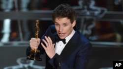 "Eddie Redmayne accepts the award for best actor in a leading role for ""The Theory of Everything"" at the Oscars on Sunday, Feb. 22, 2015,"