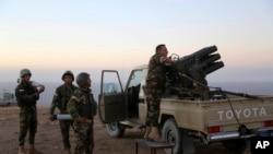نیروهای کرد در عملیات آزادسازی موصل در یکی از روستاهای اطراف شهر