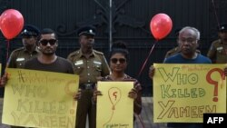 FILE - Maldivian residents living in Sri Lanka take part in a demonstration against the murder of liberal blogger Yameen Rasheed outside the Maldivian High Commission in Colombo, May 8, 2017.
