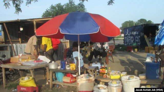 Traders are again selling goods at a market in Bor, June 18, 2014, as the town trickles back to life. Bor was one of the towns hardest hit by fighting in South Sudan.