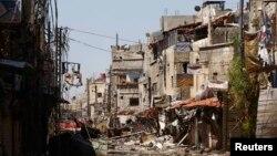지난 27일 시리아 수도 다마스쿠스의 사예다자이나브 지구에서 정부군과 반군의 교전으로 파괴된 거리. (자료사진)