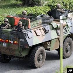 A French armored vehicle patrols a street in Abidjan Mar 31 2011