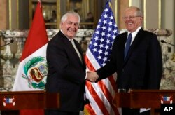 U.S. Secretary of State Rex Tillerson, left, shakes hands with Peru's President Pedro Pablo Kuczynski after a private meeting at the government palace in Lima, Peru, Feb. 6, 2018.