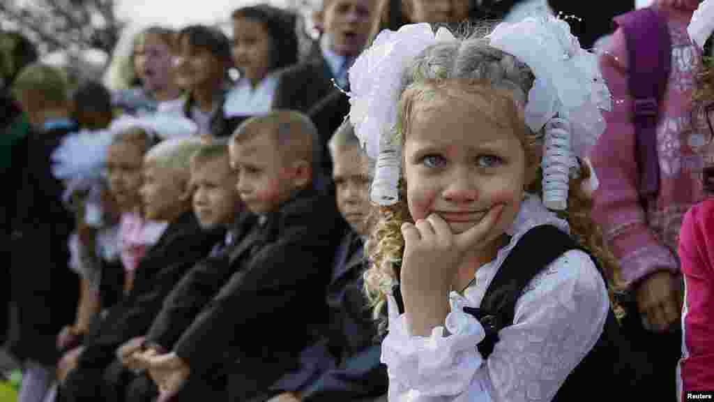 First-graders attend a festive ceremony to mark the start of another school year in Slovyansk, Ukraine, Sept. 1, 2014.
