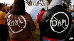 Cousins Jessica and Michelle Decoteau of Belcourt don slogans opposing the Dakota Access Pipeline in Bismarck, North Dakota, Oct. 29, 2016.