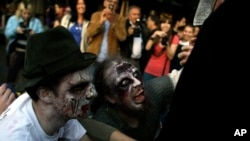 People dressed up as zombies during a 'Zombie Walk', in Belgrade, Serbia, Oct. 19, 2013.