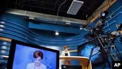 A news anchor provides the news from the studio of PIK [First Caucasus News], a new state-funded, Russian language TV channel designed to break Moscow's information grip on the region, Tbilisi, Georgia, August 2011