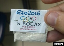 "One of dozens of packages of cocaine stamped with a Rio 2016 label, the Olympic rings, and a warning that reads, ""Keep away from children,"" confiscated by police in a raid on the Lapa neighborhood of Rio de Janeiro, July 25, 2016."