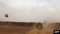 A helicopter of the French army escorting a vehicle transporting Mali's Prime Minister Moussa Mara from Gao to Kidal, May 17, 2014.