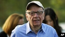 FILE - Rupert Murdoch, Australian-American media mogul and the chairman and chief executive of News Corporation, arrives at the Sun Valley Inn in Sun Valley, Idaho, July 7, 2011.