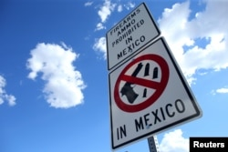 A sign warning drivers that firearms and ammunition are prohibited in Mexico is seen at the U.S.-Mexico border in Nogales, Arizona, Oct. 9, 2016.
