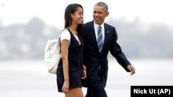 FILE - President Barack Obama and his daughter Malia walk from Marine One toward Air Force One in 2016. Malia is attending Harvard University after a gap year.
