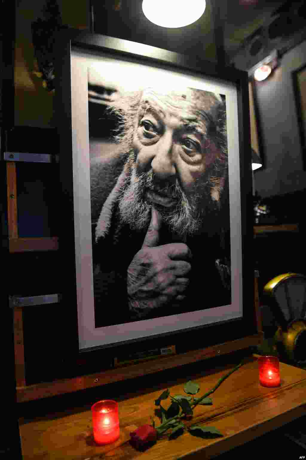 Candles and a rose have been put next to a portrait of late Turkish photographer Ara Guler at Ara Cafe in Istanbul. The legendary photographer, famed for iconic images of Istanbul which captured almost three quarters of a century of the city's history, died aged 90 on Oct. 17, 2018.