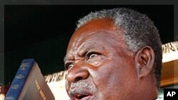 Zambia's new President Michael Sata, right, takes the oath of office on the steps of the supreme court in Lusaka, Zambia, Friday Sept. 23, 2011. Sata defeated incumbent Zambia's President Rupiah Banda in Tuesday Sept. 20 elections. The man who once threat