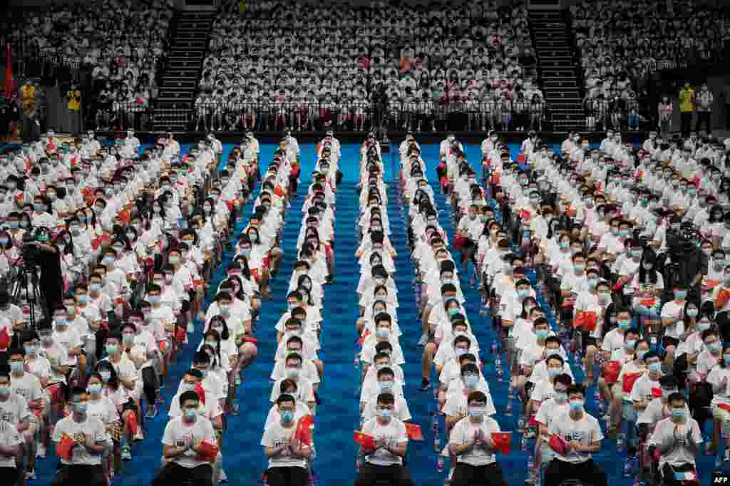 More than 7,000 students at the Huazhong University of Science and Technology attend a commencement ceremony in a gymnasium in Wuhan, in China's central Hubei province.