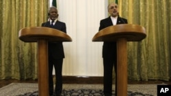 Iranian Foreign Minister Ali Akbar Salehi, right, speaks with media during a joint press conference with International envoy Kofi Annan, left, after their meeting in Tehran, Iran, July 10, 2012.