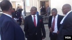 Kudakwashe Bhasikiti (second left) with his lawyer Tendai Biti (far right) - Photo By Thomas Chiripasi