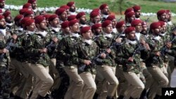 FILE - Pakistani commandos march during a military parade in Islamabad, March 23, 2016. Gul Bukhari, a Pakistani journalist who is an unusually vocal critic of Pakistan's powerful military, was freed Wednesday, several hours after being abducted.