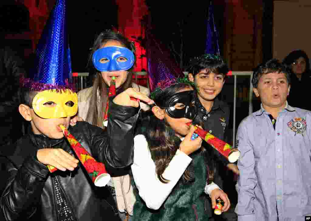 Lebanese children celebrate the New Year during a countdown event in downtown Beirut, Lebanon, Jan. 1, 2013.